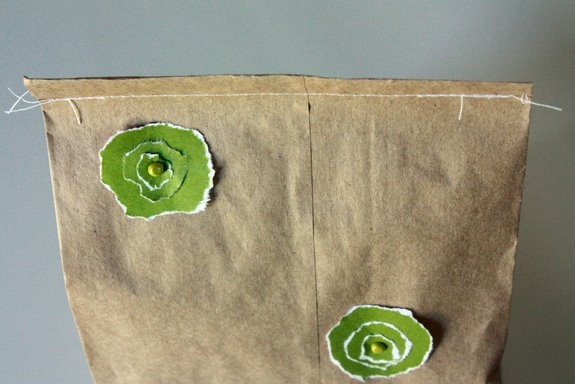 homemade gift bag: lunch sack, scrapbook brads, craft paper