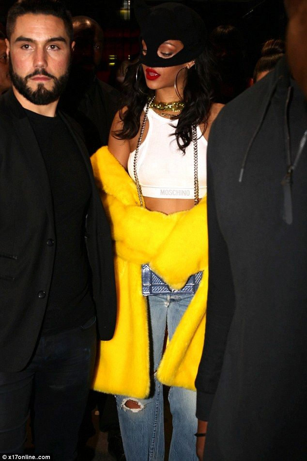 Who's that Bat-Girl? Rihanna arrived for the Jeremy Scott Paris Fashion Week Moschino party wearing an unusual choice of head-wear on Saturday night