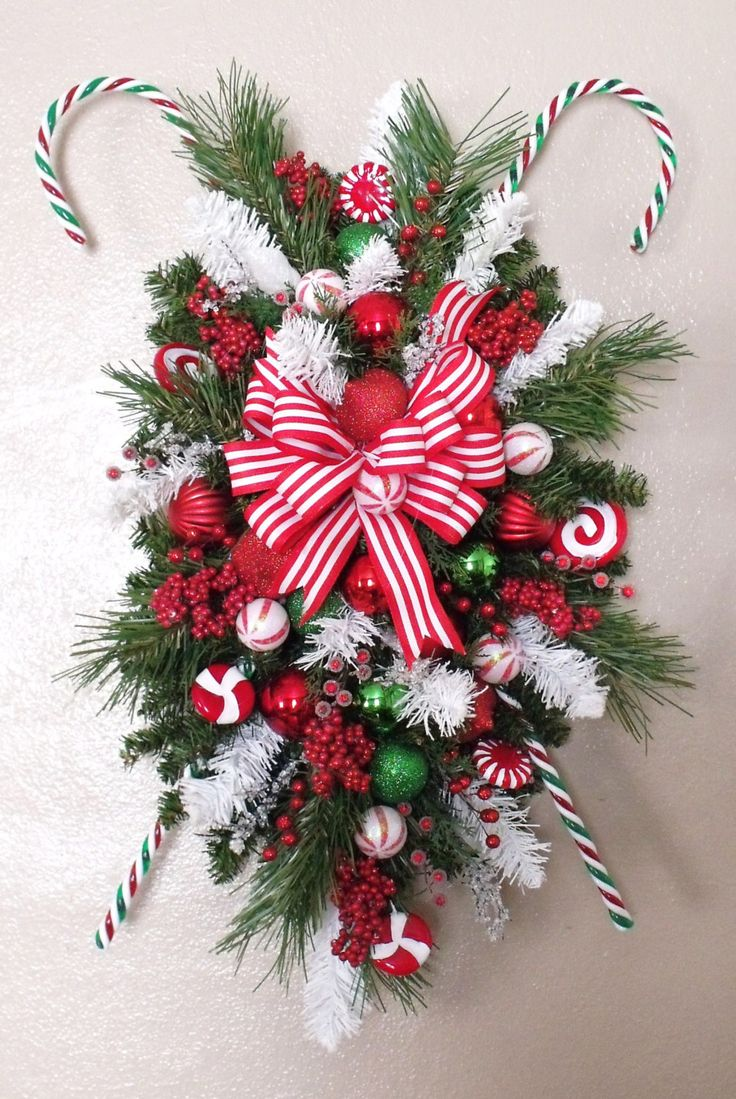 PEPPERMINT STICKS Christmas SWAG Wreath Silk Holiday Door Decor Winter Decoration Arrangement Home by professionalwreaths on Etsy https://www.etsy.com/listing/210662774/peppermint-sticks-christmas-swag-wreath