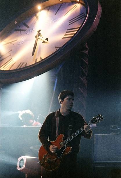 Noel Gallagher of Oasis performs on stage at The National Indoor Arena during the 'Be Here Now' tour on September 30th 1997 in Birmingham England