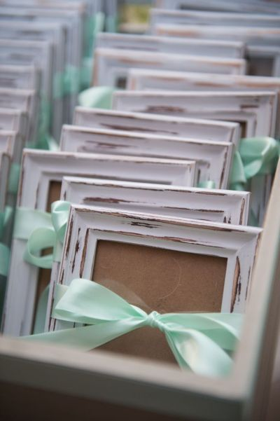 A pretty ribbon tied to the perfect picture frame is a memorable favor idea.  See more 50th birthday favors and party ideas at www.one-stop-party-ideas.com