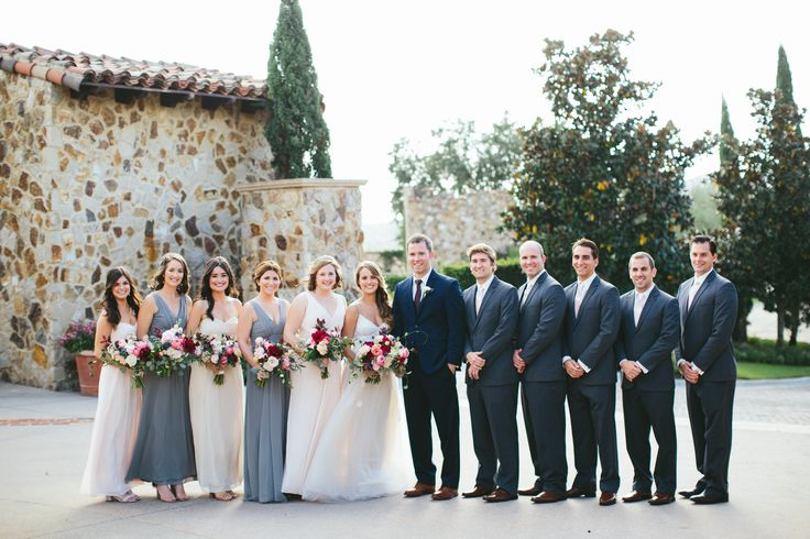 groomsmen in navy suits and bridesmaids in shades of grey and blush in this fall wedding.
