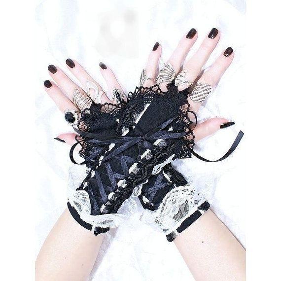 short fingerless gloves wrist warmers gothic  by FashionForWomen. https://www.etsy.com/listing/209513919/short-fingerless-gloves-wrist-warmers?ref=shop_home_active_7