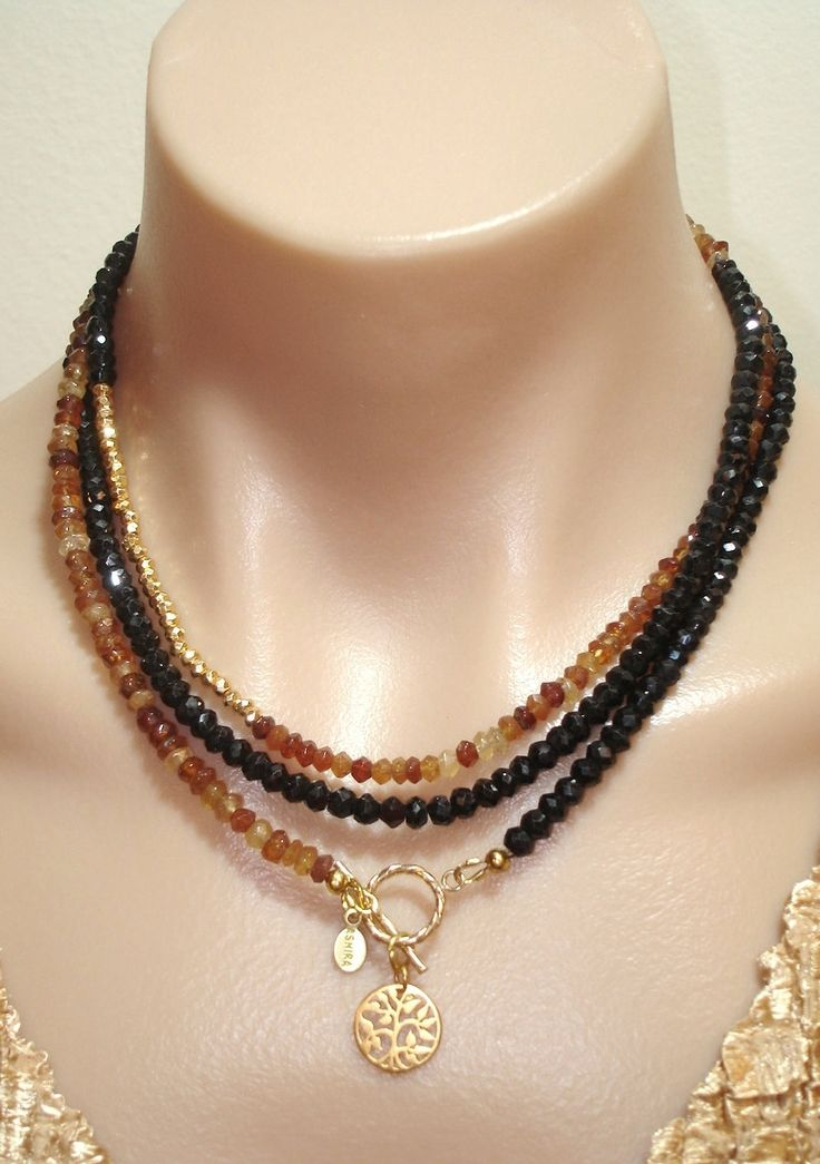 CLICK HERE TO BUY: www.etsy.com/... Ashira Black Spinel and Natural Hessonite Garnet Gemstone Necklace with Charms. $445.00, via Etsy.