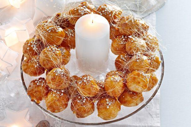 Make this amazing profiterole festive centrepiece for a stunning Christmas dessert.