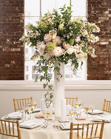 How stunning is this overflowing centerpiece in its tall milky-glass vase?