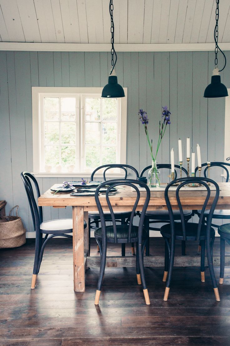 Nothing like a wash of color on shiplap wood paneled walls to add rustic refinement to a farm house dining room.