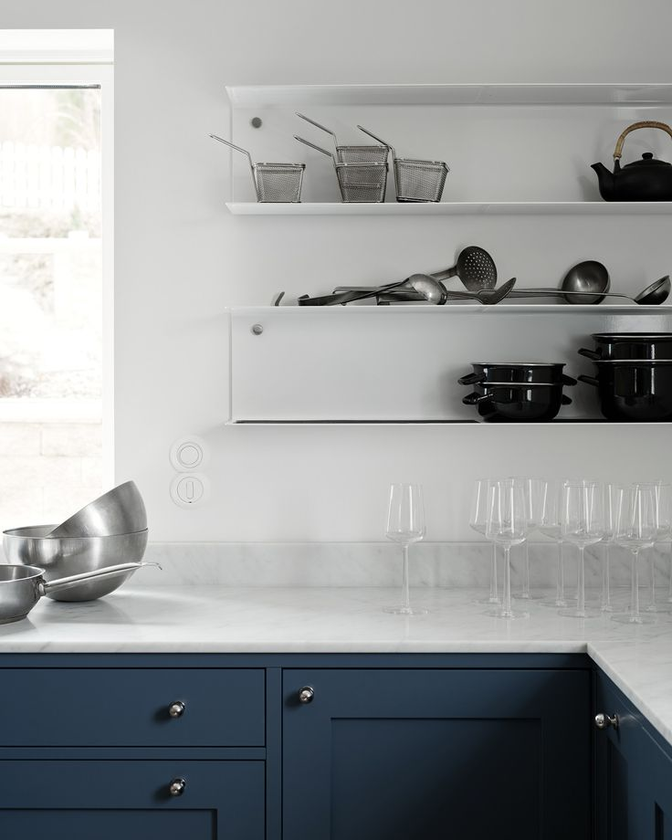 A kitchen in blue and white marble - via Coco Lapine Design blog