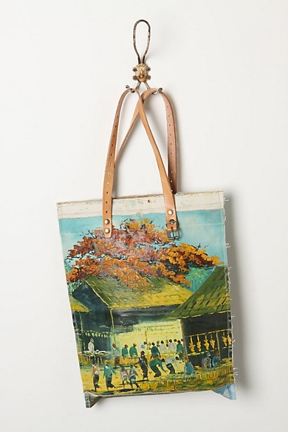 Crafted by affixing a vintage oil painting atop a repurposed canvas pouch, this handmade, one-of-a-kind tote gives new life to a forgotten masterpiece. $398 anthropologie #anthrofave #juvenilehalldesign love this.