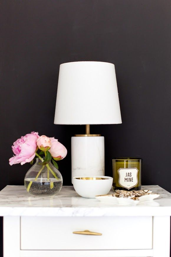 Love the gold and white bowl, lamp, candle, zebra dish... via The Vault Files