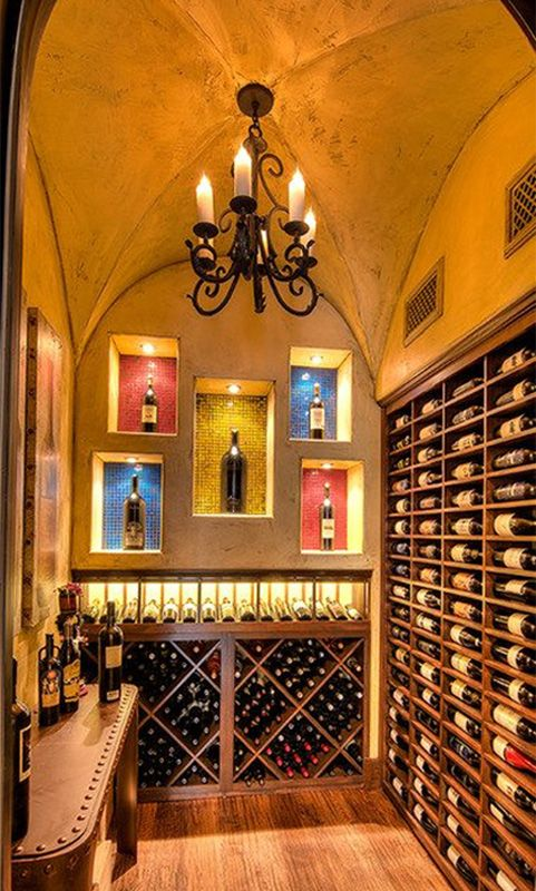 The groin vaulted ceiling in this Mediterranean-style home in Ft. Worth, Texas is the perfect backdrop for a stunning wine display. The custom mahogany racking includes diamond bins, display features with custom lighting and rows of label forward storage. A ducted wine cellar cooling system ensures the room is functional as well.