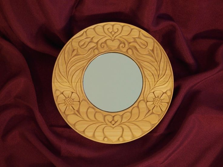 Handmade wooden carved mirror. Made from linden wood.
