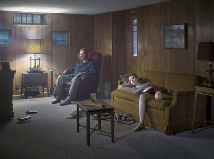 The Basement, Cathedral of the Pines Series by Gregory Crewdson 2014.  Crewdson makes a seemingly everyday activity, a typical suburban scene, seem surreal with almost unnatural looking cinematic lighting and the vacant stared of his actors.