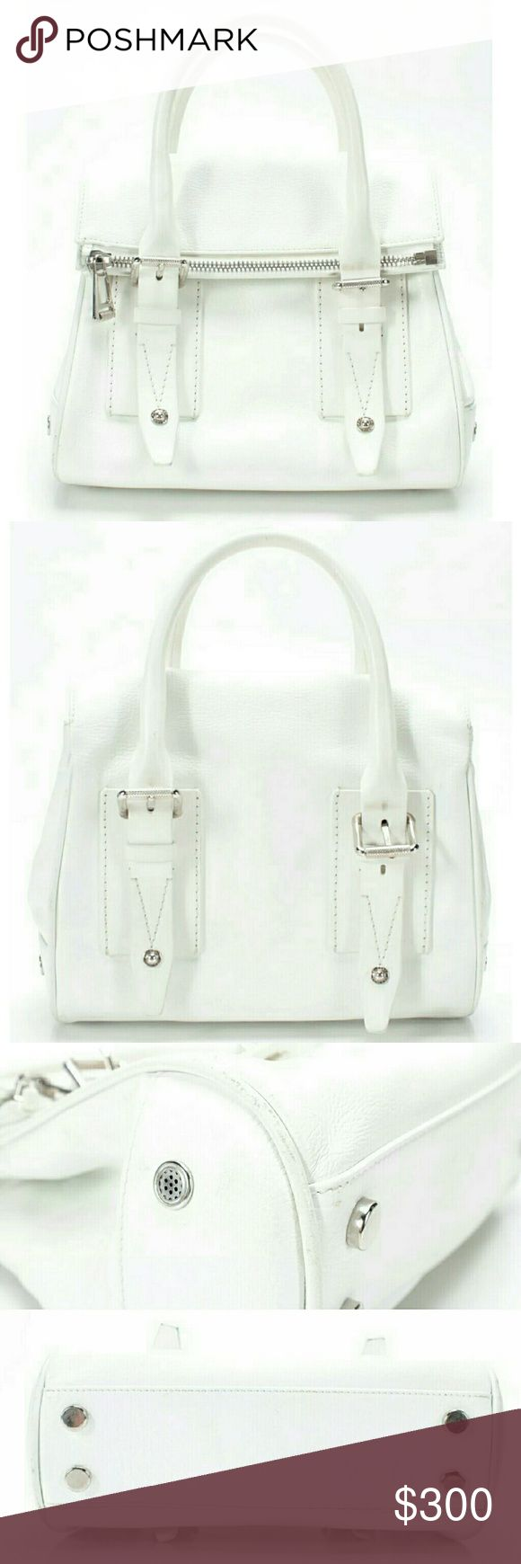 "Belstaff Dorchester 36 White Leather Satchel Bag 100% Guaranteed Authentic with email proof from Belstaff. Optic White Dorchester 36 from the Summer '14 collection. Fold-over zip top detailed with hidden magnets to secure an unzipped top; fold conceals logo applique.  Measures 11"" Long.  Made in Italy. Exterior is in good condition, hardware is prefect. Some discoloration at handles and scuffs to piping. Interior shows wear including discoloration under interior zipper and heavy marks at…"