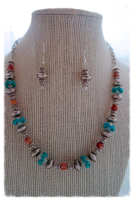 When I look at this necklace I am reminded of the southwest. Which is where I am from so that makes sense. This necklace is made up of Carnelian Agate 6 mm, Reconstituted Turquoise Stone Chevron, and Plated Silver Beading. The earrings are made with Silver Plated Beads and Nickel Free Earring Hooks. The length of the necklace from clasp to bottom bead is 8.5.