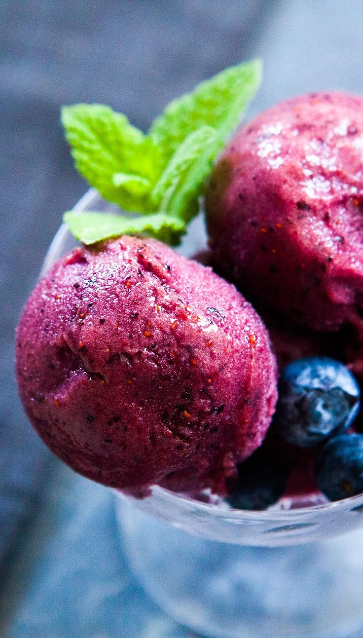 Smooth and ultra blueberry-y, homemade blueberry sorbet, perfect for a hot summer day! On SimplyRecipes.com