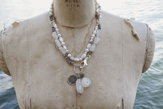 White freshwater pearls mixed with sterling silver. Fobs include an antique coin and faceted moonstones.