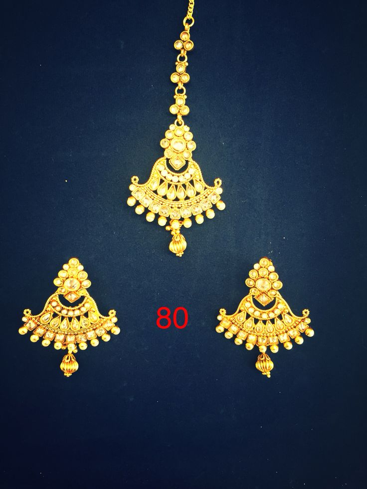 Oxidized gold, kundan and pearl earrings and tikka