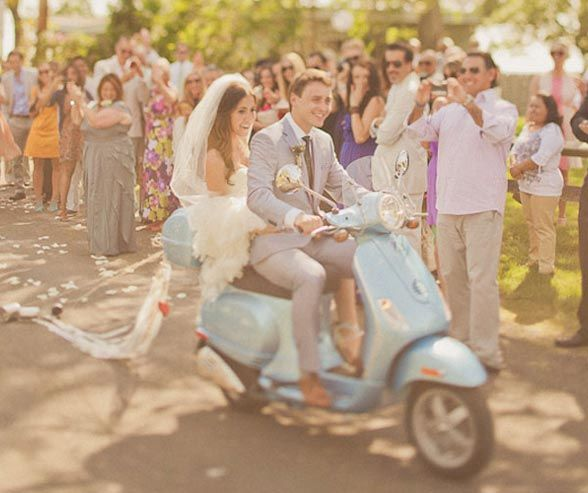 Limos aren't the only mode of wedding transportation a couple can use. Here are ideas for couples who want to try something different like this Vespa