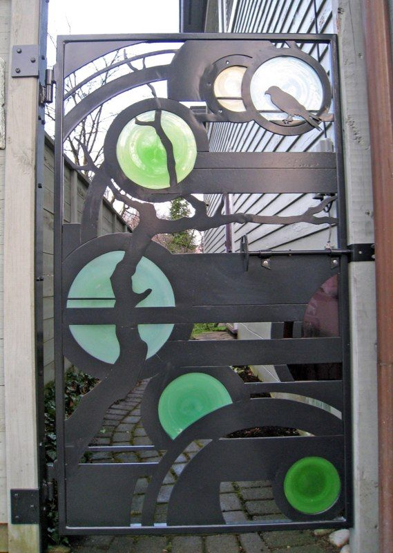 Garden gate with stained glass circle inserts.