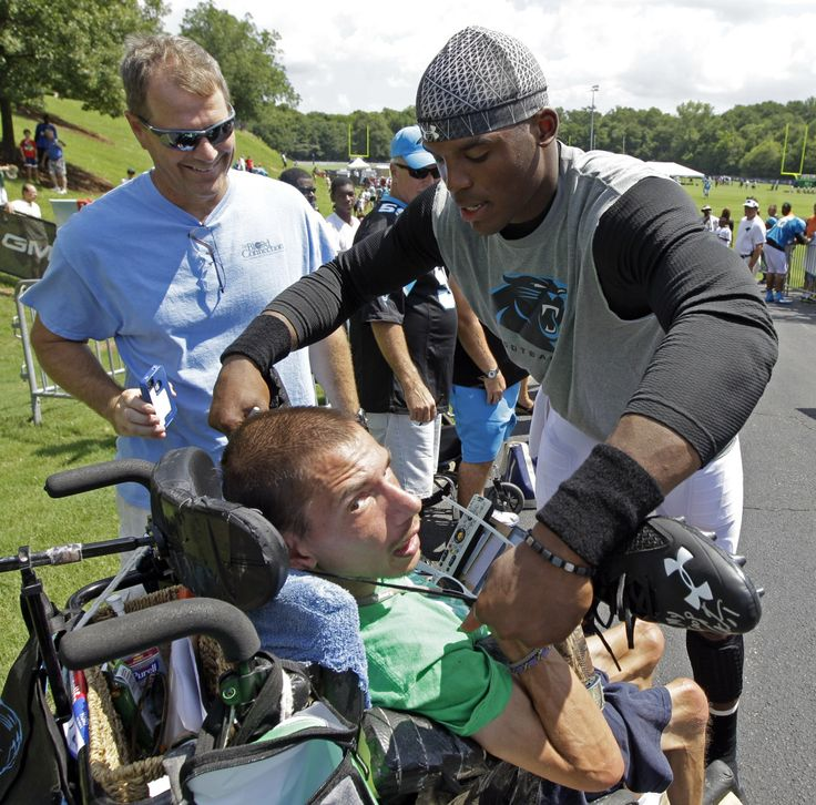 Cam Newton took off his cleats, autographed them for a fan in a wheelchair.....just another reason I think he is awesome!