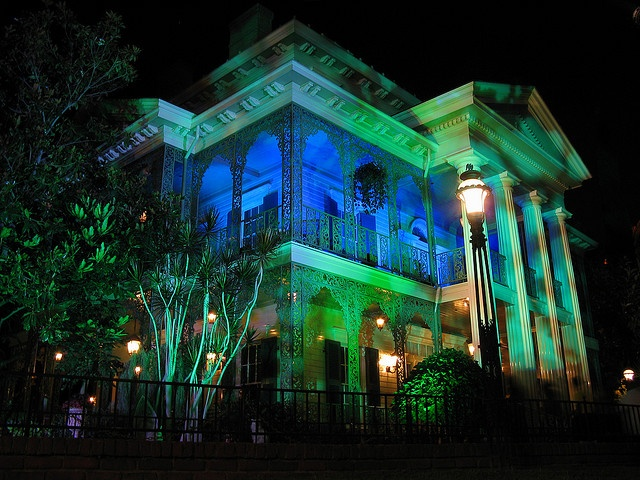 Haunted Mansion lighted in Blue and Green, Disneyland, California