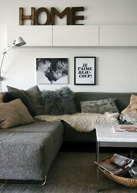 gray couch, hanging horizontal cabinets