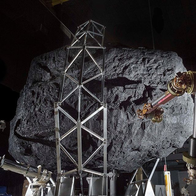 A prototype of the Asteroid Redirect Mission (ARM) robotic capture module system is tested with a mock asteroid boulder in its clutches at NASA's Goddard Space Flight Center in Greenbelt, Maryland. The robotic portion of ARM is targeted for launch in 2021. The mockup helps engineers understand the intricate operations required to collect a multi-ton boulder from an asteroid's surface. The hardware involved here includes three space frame legs with foot pads, two seven degrees of freedom arms…