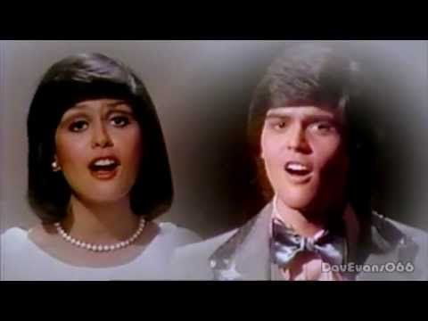 Umbrella...Donny and Marie.I used to love watching Donny & Marie.Please check out my website thanks. www.photopix.co.nz