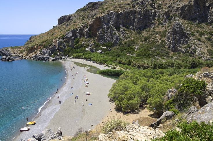Exotic Preveli beach in Crete, with palm trees in the background