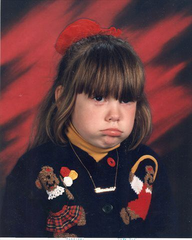 Danielle T. from Lansing, Michigan sent in her Picture Day photo from kindergarten. She wasn't too happy about her sweater, and her mother wasn't too happy about having to pay for this photo.