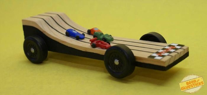 ramp shape. But we jazzed it up by making tiny Pinewood Derby cars ...