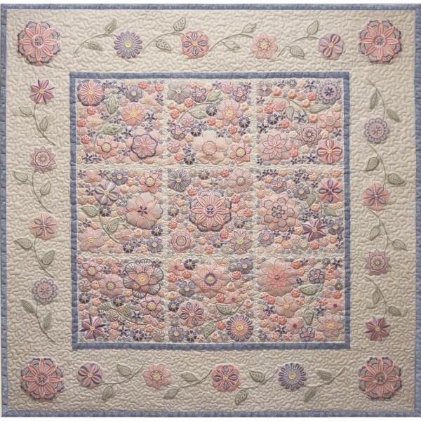 """""""Virginia"""" This beautiful #MachineEmbroidery floral quilt, is constructed with multiple hooping techniques, and includes 18 designs! Instructions are also included to create a finished quilt measuring 40 inches square! Wrap yourself up in one of your own, and get started on yours today!"""