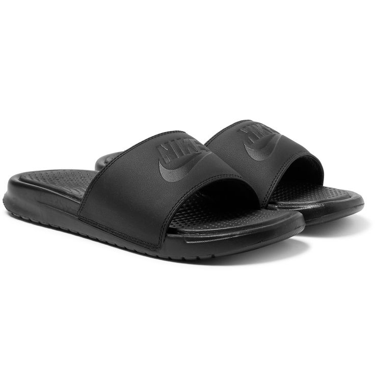 Constructed with gripped foam-enhanced soles, <a href='http://www.mrporter.com/mens/Designers/Nike'>Nike</a>'s 'Benassi' slides are lightweight and comfortable. The emblem-embossed leather straps are lined in smooth jersey and feature added cushioning, too. Wear this versatile pair on relaxed mornings around the house or pack them for warm-weather getaways to sport by the pool.