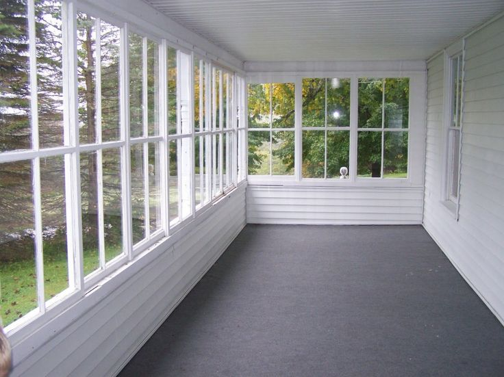Inspiration Interior. Phantasy Enclosed Porch Views And Designs: Magnificent White Enclosed Porch Wall Painted With Gray Area Full Rugs As Well As Open Glass Windowed As Decorate Sunroom Enclosed Porch Designs