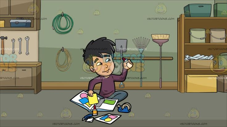 An Asian Boy Gluing Colored Sheets To His Scrapbook At A Garage With Gardening Equipment And Tools:  A boy with black hair wearing a dark purple sweatshirt and gray pants sitting on the floor smirks while holding a glue bottle with a red lid in his left hand that he uses to make his scrapbook collection with several other supplies like a tape in a blue dispenser cutter and colored papers. Set in a garage with olive green wall natural oak moulding gray floor wooden shelves and counters a…
