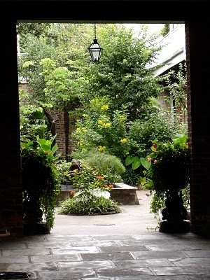 A private courtyard garden - French Quarter - quite like the idea of a light hanging in the middle. definitely need some lighting.
