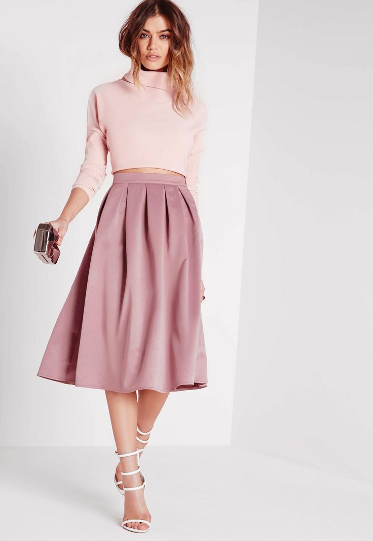 For the ultimate ladylike look this season, grab this full midi skirt in a dreamy mauve hue. This elegant piece nips in at the waist and comes out to a full shape, giving your silhouette amazing definition. Featuring side zip fastening with...