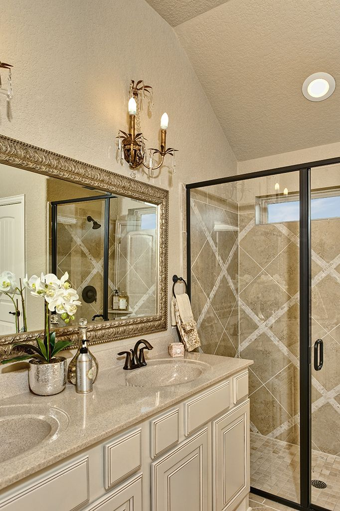 Gehan Homes Master Bathroom Cream Granite Brushed Gold Mirror Tile Design Candelabra Light