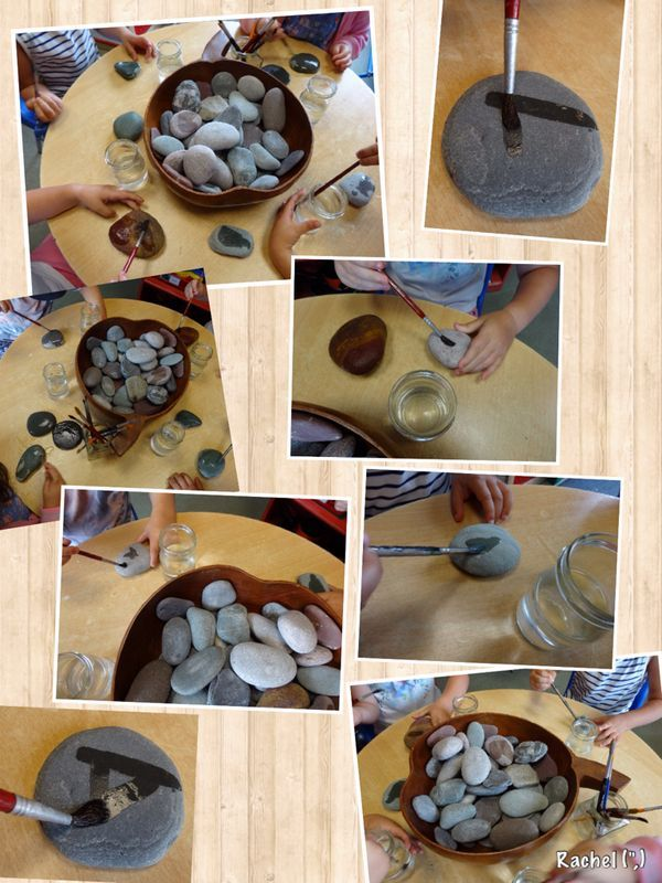 Painting stones with water...great set-up on the science area table for a few days
