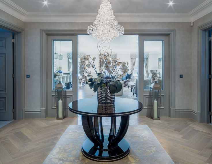 As this stunning chandelier hangs delicately over the rounded table, the hallway in our latest project tells a story of opulence, receiving guests with an air of grace and grandeur. #interiordesign #luxurylife #luxury #london #luxuryproperty #luxuryhomes #londonproperty #luxuryinteriors