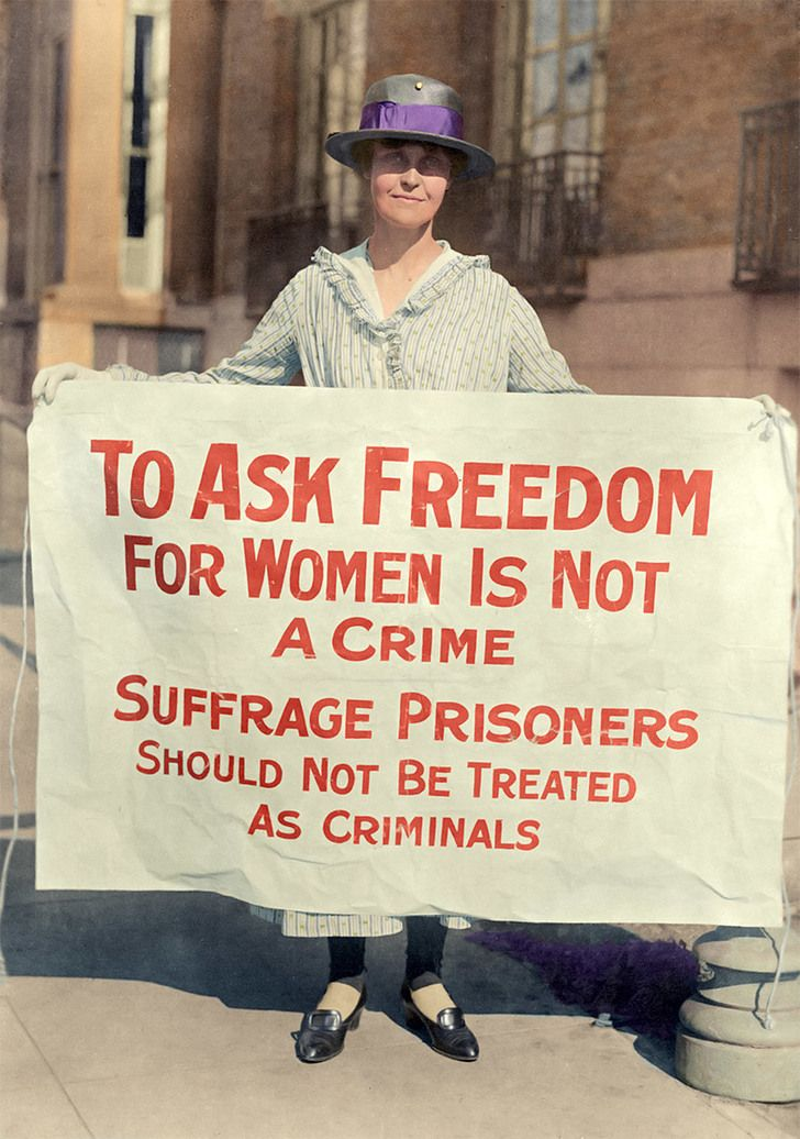 Mary Winsor, founder and president of the Limited Suffrage Society, holds a sign during the American suffrage movement; ca. 1917.