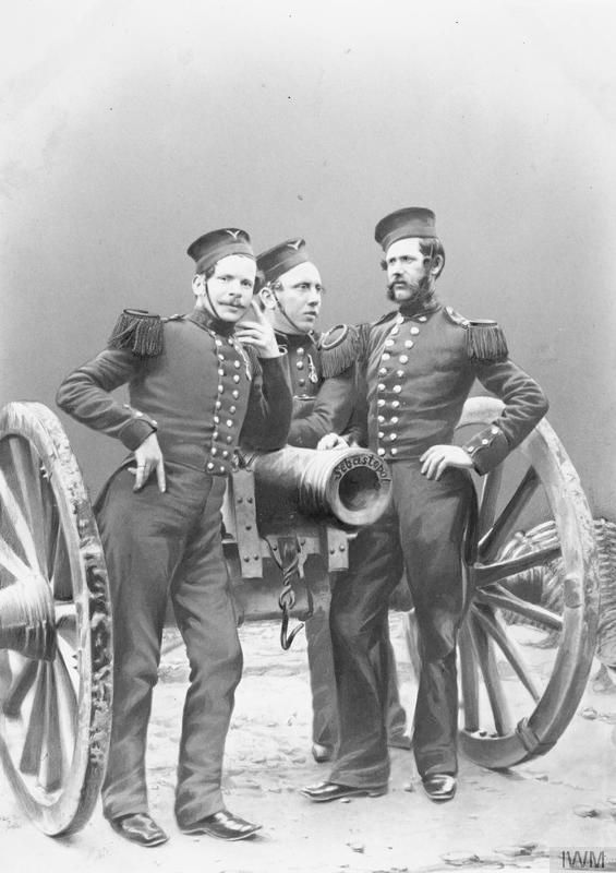 Corporal Murphy and two other soldiers of the Royal Artillery with a gun which was captured at Sevastopol and brought back to England as a war trophy, 1856. © IWM (Q 71614)