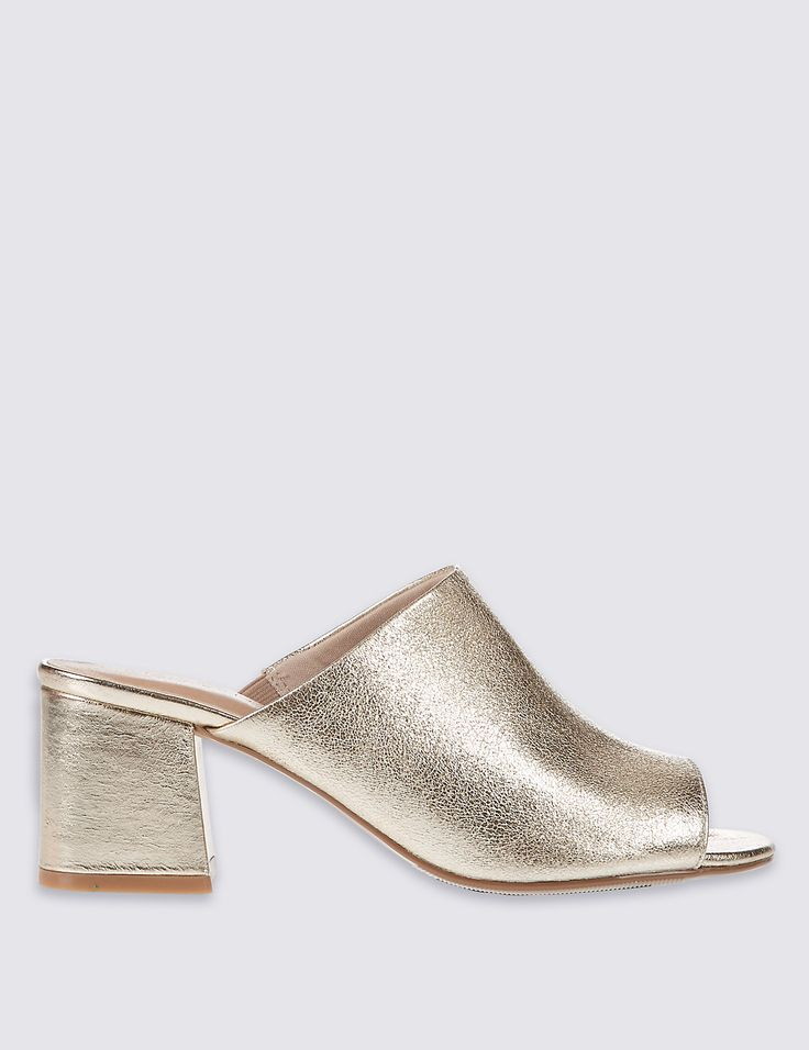 Perfectly sculpted, these peep-toe mules strike the balance of modern retro. Shimmering gold takes you easily from day-to-night - best worn with frayed denim or a ditsy summer dress. Insolia redistributes your weight away from the balls of your feet, reducing pressure and increasing ankle stability, allowing you to wear your heels comfortably all day long. Insolia is endorsed by the UK College of Podiatrists. Perfectly sculpted, these peep-toe mules strike the balance of modern retro…
