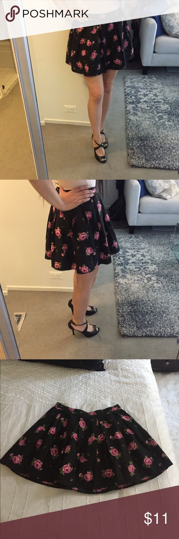 Forever 21 floral skirt Great condition, beautiful black skirt with vibrant roses. This skirt is lined. The material remind me of  finer grosgrain ribbon. This is one of my favorite skirts to wear. Shoes also for sale. Forever 21 Skirts
