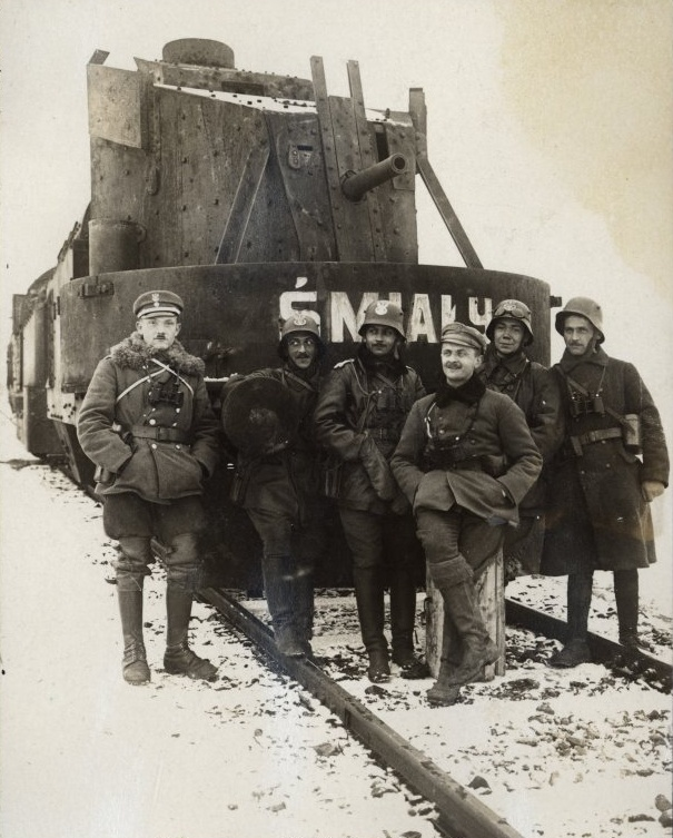 Polish soldiers pose in front of the armored train named Śmiały which changed hands four times in its career, December, 1919.
