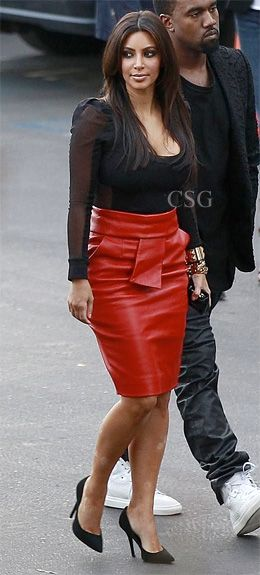 Keeping Up With The Kardashians star #KimKardashian wore the red Balenciaga Femme Leather bow skirt arriving arrive at an 'X-Factor' taping with rapper Kanye West in Los Angeles, CA on November 21, 2012.