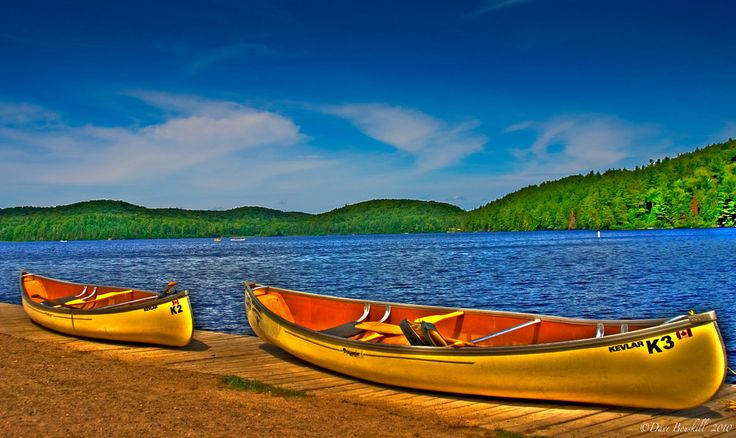 canoes awaiting a couples adventure through Algonquin Park