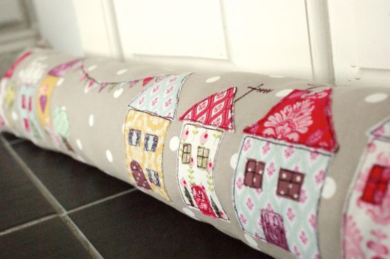 Draught Excluder with free-hand machine embroidery houses via Emily Carlill: