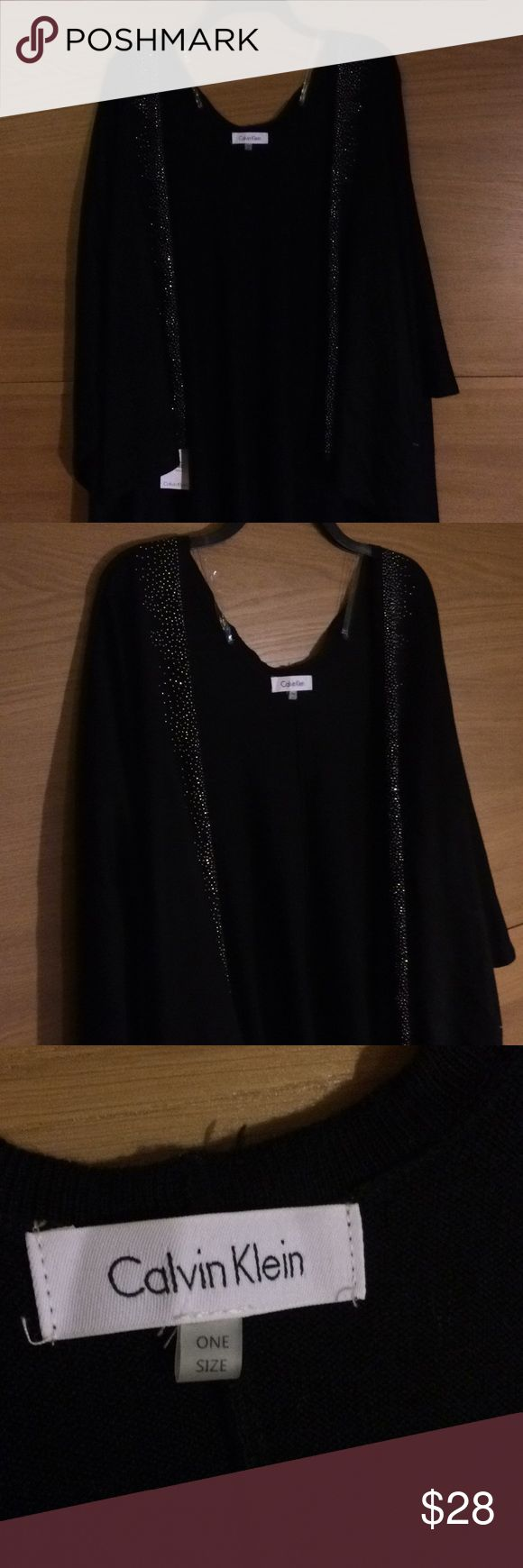 """Calvin Klein Black Shall or poncho NEW! Women's Calvin Klein Studded Poncho - Black - Ponchos Delicate metallic studwork lends a soft, twinkling quality to the borders of a cozy knit poncho from Calvin Klein. Measures approximately 48"""" x 58"""". Metallic stud accents along front opening. Fabric Content: Acrylic. Disclaimer: Photo may have been enlarged and or enhanced. Calvin Klein Other"""